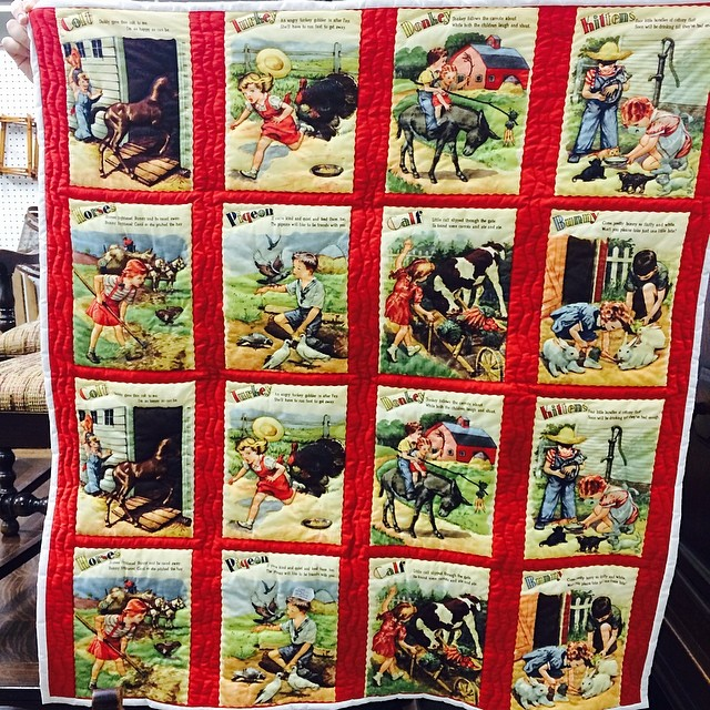 Cute quilt at the market today. Storybook panels. #quilt