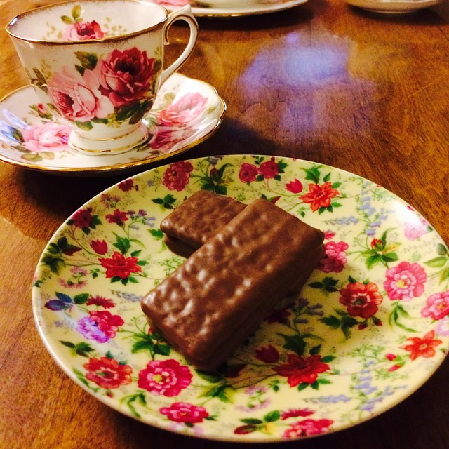 Trying out a new tea time treat. #timtam #yum #dessert #teatime #tea #royalalbert #americanbeauty #vintage